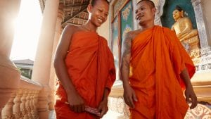 Two monks in Phnom Penh in Cambodia, included in tours offered with Asia Vacation Group