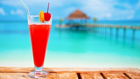 Illustration of vacation tour packages with cocktails by a pool