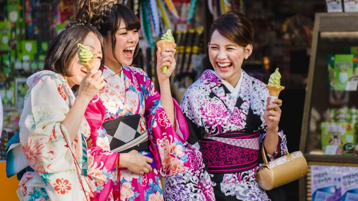 Kimono girls smiling having ice cream in Japan, included in tours offered by Asia Vacation Group