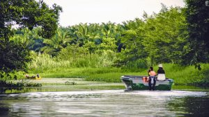 Kinabatangan River Tourists on river boating, included in tours offered by Asia Vacation Group