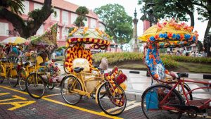 Decorated Trishaw Lineup On Street in Malacca, Malaysia, included in tours offered by Asia Vacation Group