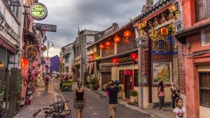 People walking on street in Georgetown, Penang, Malaysia, included in tours offered by Asia Vacation Group