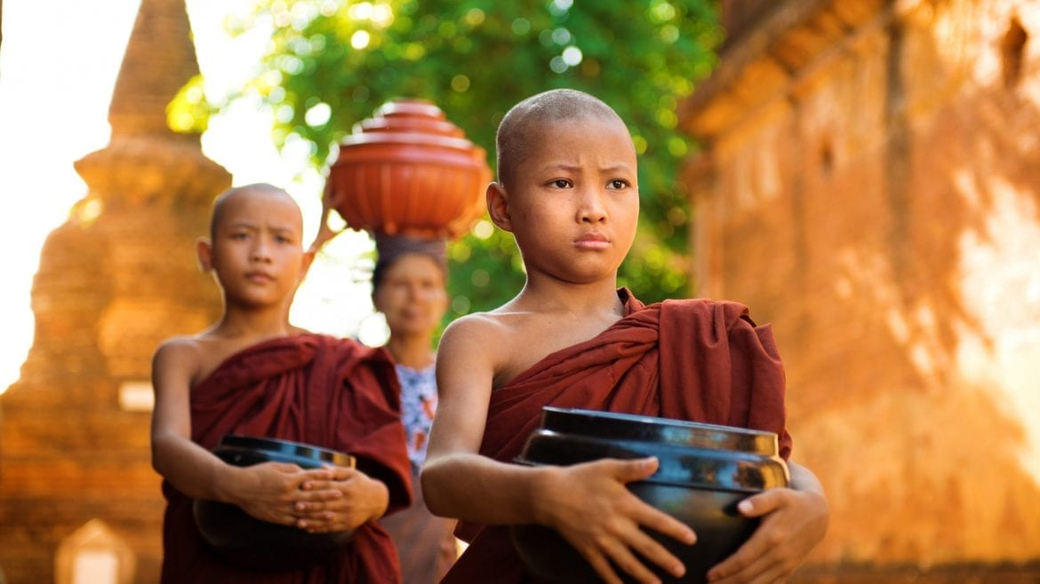 Close view of young buddhist monks in Bagan, Myanmar, included in tours offered by Asia Vacation Group