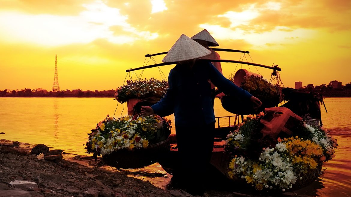 Hanoi Women selling flowers, included in tours offered by Asia Vacation Group