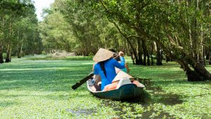 Mekong delta river people on boat in Hau giang, Vietnam, included in tours offered by Asia Vacation Group
