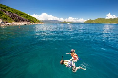 Snorkeling near an island in Nha Trang, Vietnam, included in tours offered by Asia Vacation Group